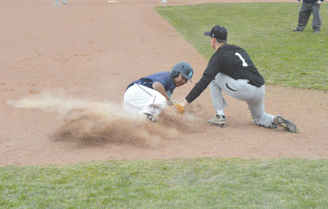 Fairborn extra hitter Saysh Martinez slides into third base, during Monday's March 19 high school baseball scrimmage opener against Graham at Fairborn High. Martinez was called out on the play.
