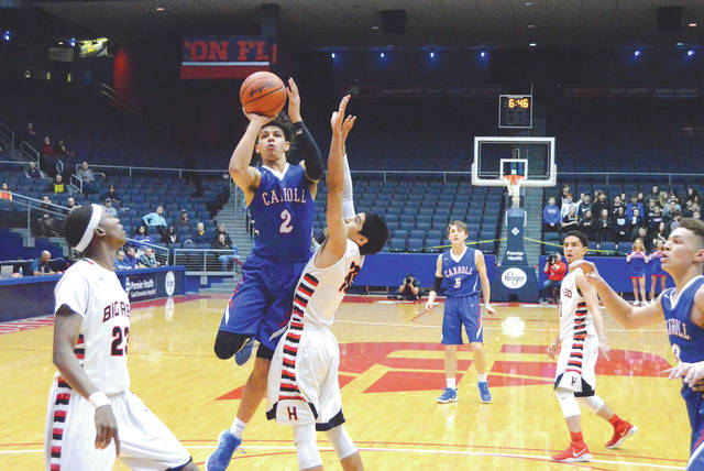 Carroll senior Eli Ramsey (2) puts up a shot in the first half of Thursday's boys high school basketball Division II district title game against Cincinnati Hughes, at UD Arena in Dayton. Ramsey led the Patriots with 13 points in the 57-38 loss.
