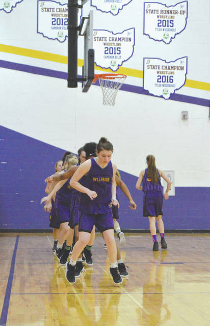 Senior Bekah Vine leads the Bellbrook High School girls basketball team through some footwork agility drills prior to the team's final home practice March 14 in Bellbrook. The Golden Eagles will be competing in the Division II state semifinals at 1 p.m. Friday, March 16 in Columbus.