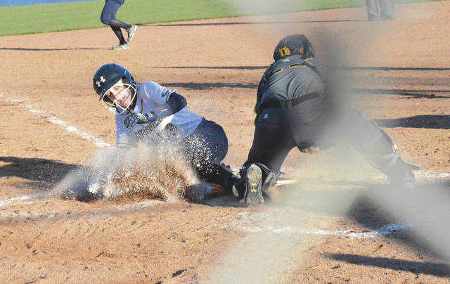 Cedarville University pinch runner McKenna Smith slides home with the winning run in Game 2 of a Great Midwest Athletic Conference softball doubleheader against visiting Ohio Dominican University, Friday March 23 at Lady Jacket Field in Cedarville. It was the first G-MAC games for both schools, both won by the Yellow Jackets.