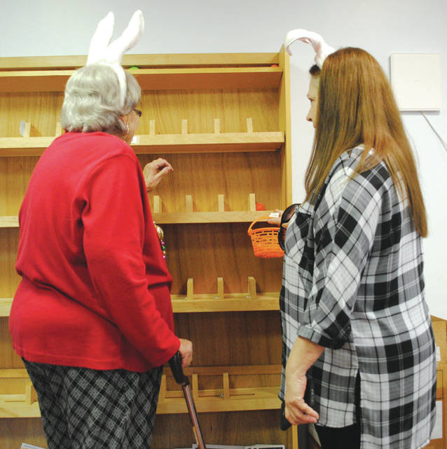 Whitney Vickers | Greene County News Fairborn Senior Center members were tasked with hunting more than 250 eggs hidden throughout the facility. Eggs were hidden in windowsills, on shelves, inside drawers, within plants and on top of wall decorations, among other places.