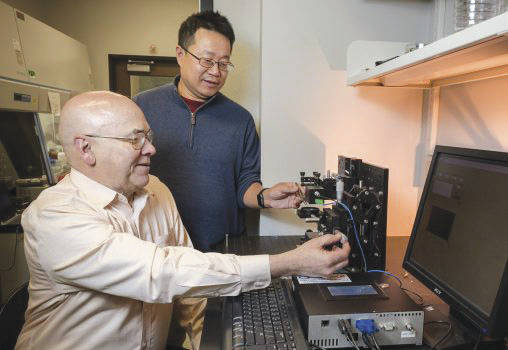 Submitted photo Research by Elliott Brown, the Ohio Research Scholars endowed chair in sensors physics, left, and Weidong Zhang, research physicist, helped create expanded applications of graphene in everything from space exploration to all-weather sensors.