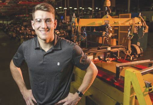 Submitted photo Wright State University mechanical engineering student R.J. McCoy helped design a new axle line at Navistar's truck plant in Springfield as part of an internship.