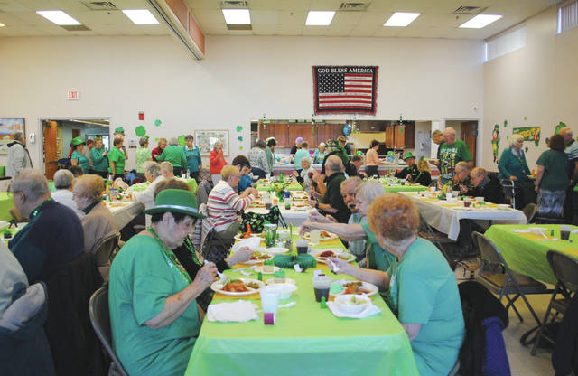 Whitney Vickers | Greene County News The Faiborn Senior Center hosted a St. Patrick's Day celebration March 16, inviting members to the facility to enjoy a meal — complete with green mashed potatoes — and dawn their best green attire.