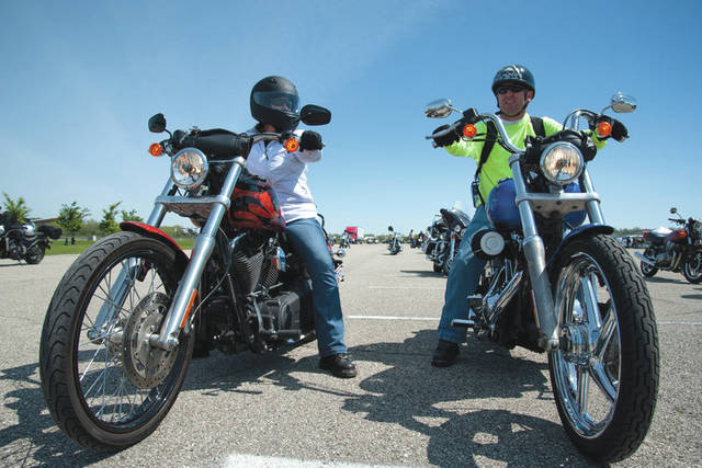 Submitted photo Tech Sgt. Wayne McNutt, National Air and Space Intelligence Center intelligence analyst (right), waits with his wife, Angela, before heading out on one of the group rides as part of Wright-Patterson Motorcycle Safety Day held at the National Museum of the United States Air Force May 6, 2016.