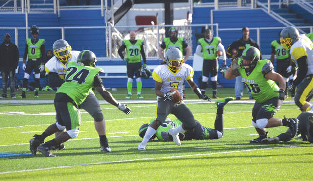 Ohio Valley Scouts quarterback Rashawn Cook (7) cuts behind a block by Saints teammate Cody Jones for a short gain, Saturday, April 7 in a semi-professional football game with the Dayton Hornets on Roger Glass Stadium's John Q. Sherman Field in downtown Dayton.