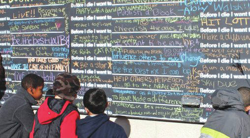 Submitted photo The Before I Die Wall encourages students to write about things they would like to do before they die.