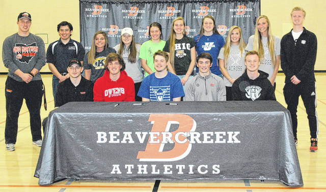 Scott Halasz | Greene County News Beavercreek High School held a signing ceremony April 11 for 16 athletes who will be playing college sports next school year. Front row — Ian Heiland (wrestling, Ohio Northern University); Gary DeMartino (baseball, Owens College); Bryce Neuse (football, Luther College); Dominic Calabrese (soccer, Ohio Wesleyan University); and Ryan Bernt (soccer, Indiana University-Purdue University Fort Wayne). Back row — Noah Koenig (Ohio Northern University, football); William Wells (lacrosse, Lincoln Memorial University); Sydney Smith (lacrosse, Kent State University); Emily Mathes (lacrosse, Wilmington College); Tiffany Haynes (soccer, Wilmington College); Stephanie Pierce (cross country and track, Ohio University); Bailey Draughn (basketball, Urbana University); Cami Bissett (lacrosse, Palm Beach Atlantic University); Madalyn Frye (lacrosse, Palm Beach Atlantic University); and Daniel Donohue (soccer, Indiana University-Purdue University Fort Wayne). Beavercreek senior Connor Davey signs to play football at Wittenberg University.