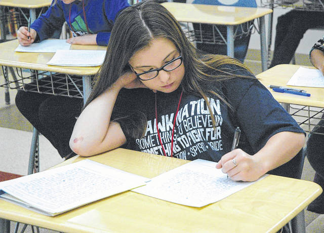 Baker Middle School student Haley Miller finished up a page of her writing during the PenOhio regional championship April 21.