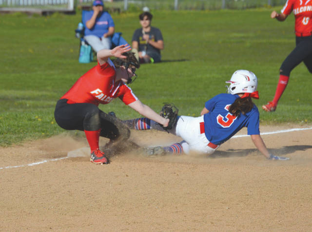 Fenwick third baseman Abby Gustely applies the tag on a sliding Camryn Joseph of Carroll (3) on a sixth inning ending shortstop-to-first-to-third double play, April 28 at Carroll High School.