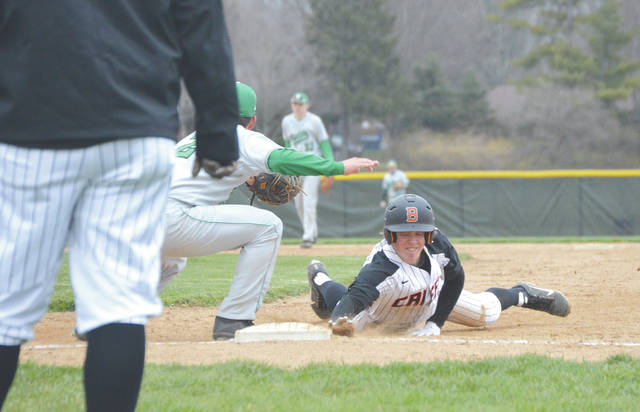 Senior Gary DeMartino dives safely back to first base, as Northmont's Ryan Pullens looks to make the catch, during Friday's April 6 high school baseball game at Beavercreek High School.