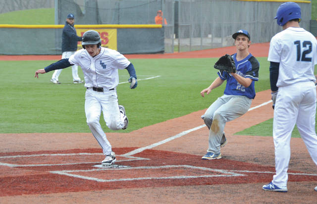 Legacy Christian's Josh Frueh scores on a wild pitch in the second inning of Tuesday's April 24 baseball game on Grady's Field at the Athletes In Action Sports Complex in Xenia. Legacy Christian defeated Yellow Springs, 10-0, in five innings.