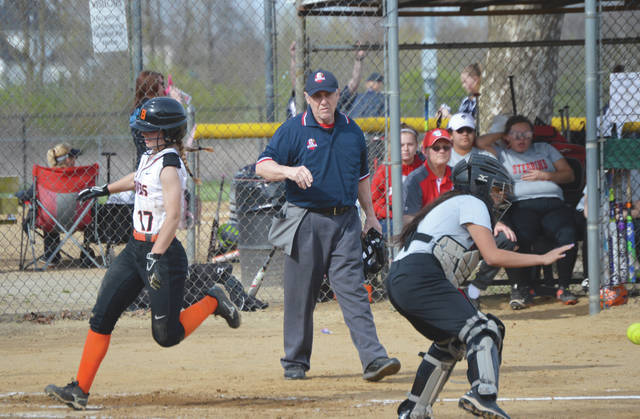 Maddie Neibert (17) races home ahead of the throw to score Beavercreek's first run in a 16-2 run-ruled win over Stebbins, April 26 at Rotary Park in Beavercreek.