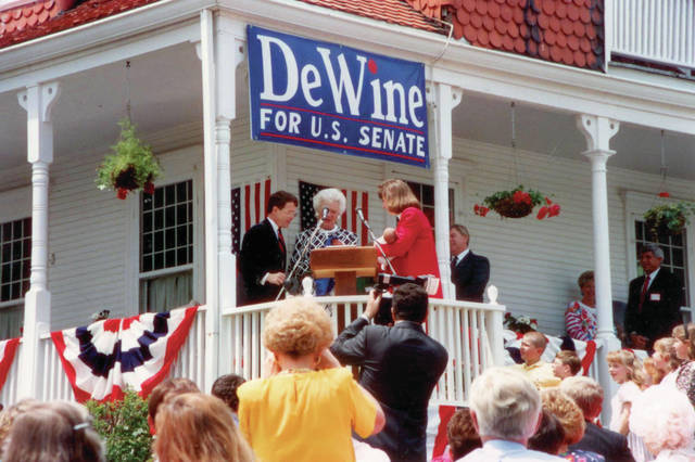 First Lady Barbara Bush speaks on our front porch in Cedarville in May 1992. Mike and I welcome her with our newborn baby.