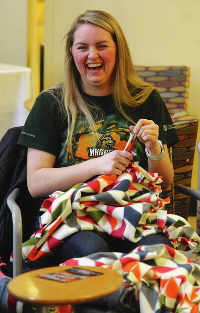 Anna Bolton | Greene County News Wright State University students tied over 500 fleece blankets April 5 for local children in need during a Project Linus Blanket Making Marathon in the Student Union Atrium. Project Linus is a national organization that has delivered over six million blankets to children in need since 1995. Preparation began in September 2017, when students raised $5,000 and cut fabric.