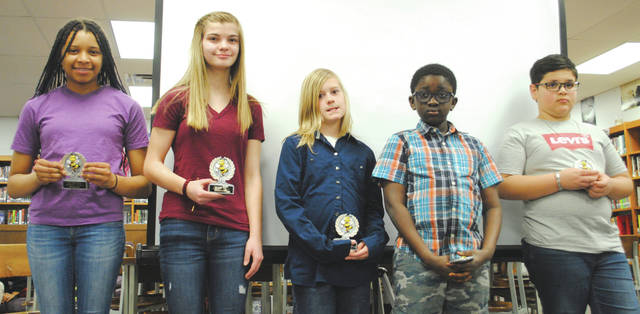 Whitney Vickers | Greene County News Fairborn City School officials praised the spelling bee winners April 12 at the regular school board meeting. Fairborn Intermediate School winners included fifth-grader Tyler Crowder (third place), fourth-grader Kvader Somb (second place) and Yousif Almarfagi (school winner). Baker Middle School winners included Brooklyn Dalton and JayAna Lewis (tied for second place) and Keiana Briscoe, who placed first and will be moving on to represent Fairborn City Schools at the district competition.
