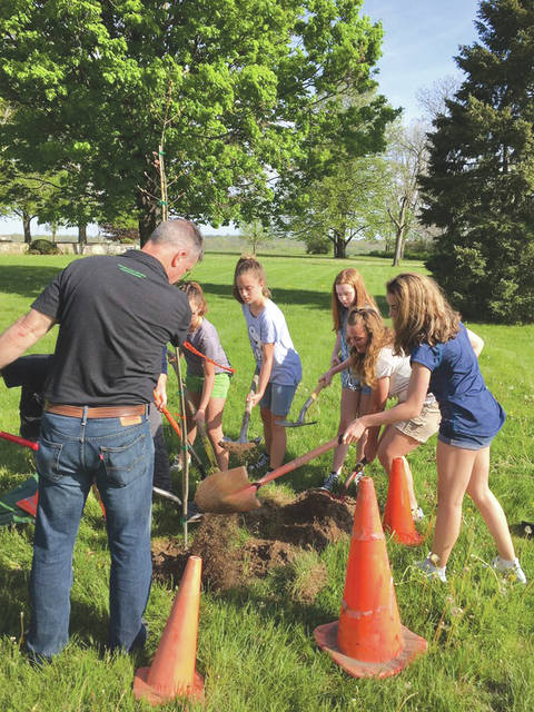 Submitted photo Fairborn City School children planted a tree last year for Arbor Day. Fairborn City Schools, the National Park Service and the 88th Civil Engineering Group will partner this year by planting a tree May 4 at 10 a.m. at the Wright Memorial Area B