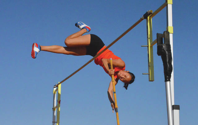 Beavercreek sophomore Eileen Chang clears the pole vault height of 12 feet, 4 inches to win defend her regional title, May 25, at the Division I regional track and field championships at Heidkamp Stadium in Huber Heights.