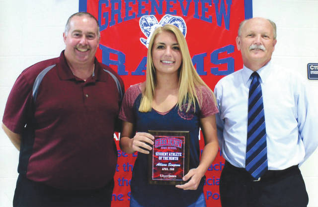 Allison Simpson (center, with Greeneview Athletic Director Mark Rinehart and Mike Reed) was chosen as the Edward Jones Investments Athlete of the Month for April for Greeneview High School. This award is being sponsored by the office of Mike Reed at Edward Jones Investments of Xenia, serving Xenia, Jamestown, Cedarville and surrounding areas. Simpson, a senior on the softball team, is a returning captain of the softball team. Through 11 games, Simpson batted .471 with three doubles, a triple, nine runs batted in, eight runs scored and only one strikeout. The four-year letterman had a 98-percent fielding percentage as well. Simpson was a first-team all Ohio Heritage Conference selection. Her grade-point average is 3.7, and 3.9 cumulative. She also participated on the Softball leadership council and is a member of the National Honor Society.