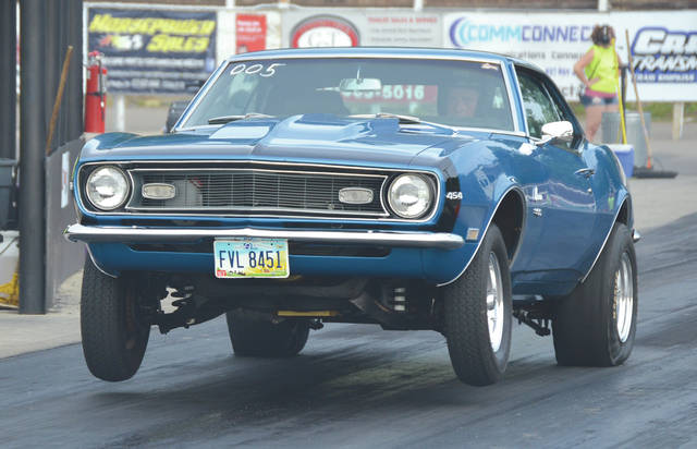 Drivers were preparing their machines for three scheduled weekend races at Kil-Kare Speedway on May 31 in Xenia. Here, the driver of this 1968 Chevy Camaro gets the wheels up on the starting line at the drag strip during Test & Tune Thursday. The drag racers will compete Friday and Saturday at the strip.