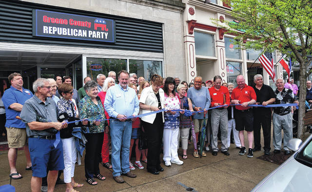 Barb Slone | Greene County News Members of the Greene County Republican Party held a ribbon cutting for their new headquarters during Xenia' First Fridays May 4. The HQ will not close after the election, as it had in the past, according to a release from the party.