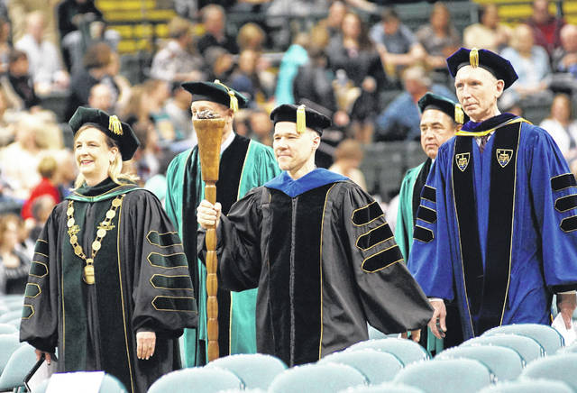 Wright State University President Cheryl Schrader and the university leadership march into the Ervin J. Nutter Center to preside over commencement.