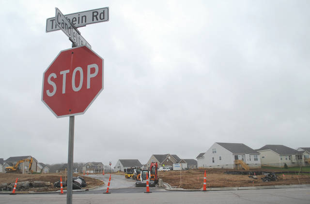 Whitney Vickers | Greene County News Representative of Northgate and Candlelite Homeowners Associations expressed concerns about stormwater draining down from the expanded Bluffs into their neighborhoods.