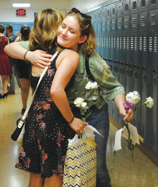 Whitney Vickers | Greene County News Fairborn High School seniors walked the halls for the final time May 23. Teachers and underclassmen lined the hallways to say goodbye with hugs, flowers and well wishes.