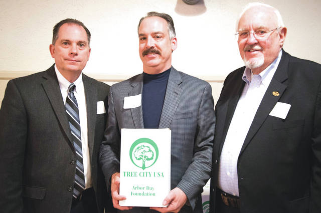 Submitted photo Mr. Michael Howe, 88th Air Base Wing Civil Engineer deputy director (center) represented Wright-Patterson Air Force Base during a Tree City USA recognition ceremony in Miamsburg. Wright-Patt has been a Tree City USA community for the past 21 years.