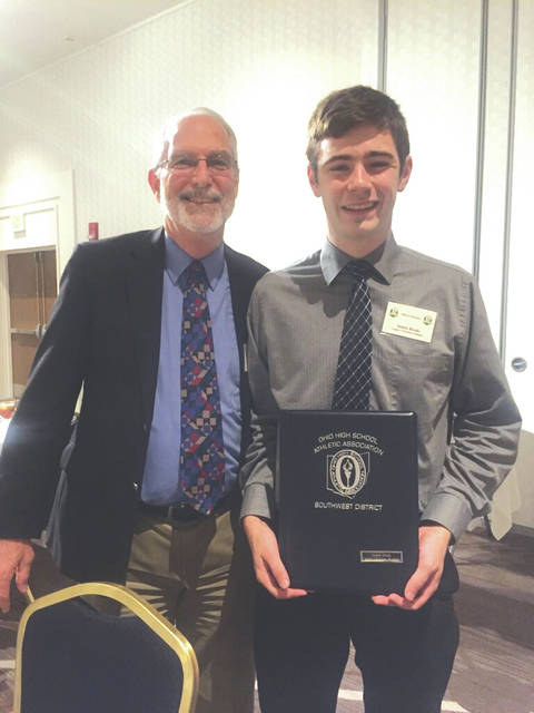 Legacy Christian Academy graduated senior James Brad (right with LCA Principal Greg Scheck) received a Southwest District student-athlete scholarship June 19 at an OHSAA Southwest District awards ceremony in Dayton. Carroll's Justin Dirksen also was a scholarship recipient.