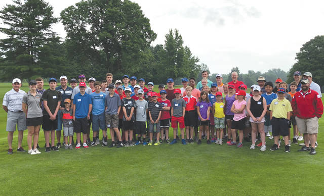 Staff and playing members of the 32nd annual Miami Valley Junior Golf Association camp pose for a group photo, recently, at WGC Golf Course in Xenia. Thirty-nine boys and 10 girls learned the correct techniques for hitting irons and woods and putting. They also were taught golf etiquette and the rules of golf.