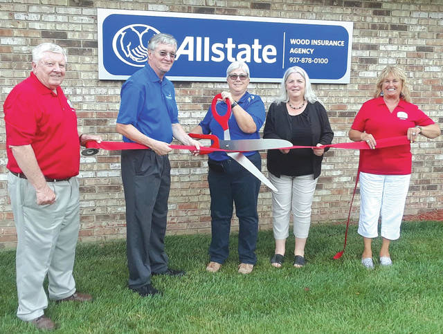 Submitted photo The Fairborn Area Chamber of Commerce recently hosted a ribbon cutting ceremony for the Wood Insurance Agency. Pictured from left to right are Chamber Ambassador Paul Newman, Councilman Tim Steininger, Agency Owner Leslie Hahn, Agency Manager Robin Syx and Ambassador Linda Hall.
