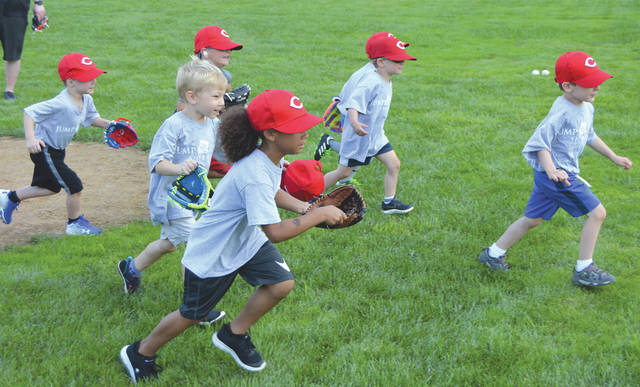 You've got to start somewhere. A group of youngsters in the JumpStart youth baseball program learn how to run to first base, at Rotary Park in Beavercreek.