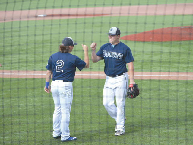 Carter Boswell (2) congratulates Luke Boylson after the Xenia Scouts regular right fielder pitched well in relief Saturday, June 30 at Grady's Field, against the Licking County Settlers.
