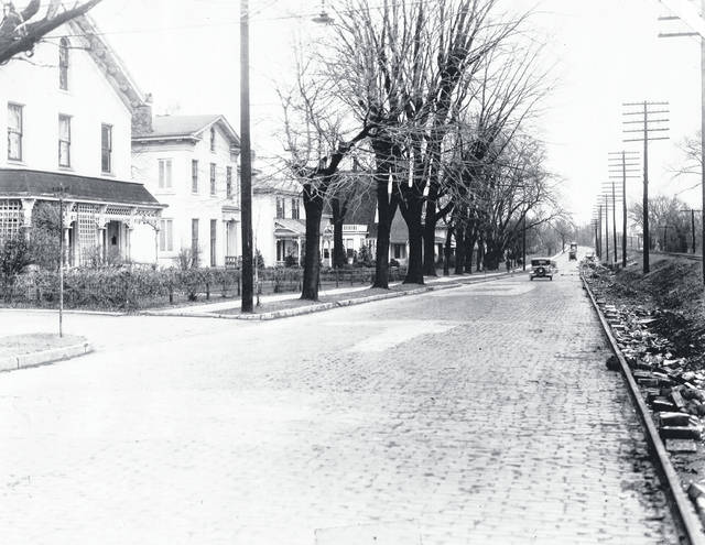 Courtesy of Greene County Historical Society Cars drive down North Detroit Street past King Avenue, about 1931. Just to the left out of the picture would become the current Huntington Bank.