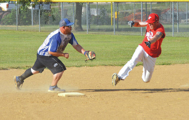 J.B. Barrett of the Beavercreek Bombers applies the tag to a Peace Lutheran baserunner at second base, during Tuesday's 6 p.m. Coed Softball League action at Beavercreek's Rotary Park. The Bombers won the game, 11-4 to remain undefeated this season.