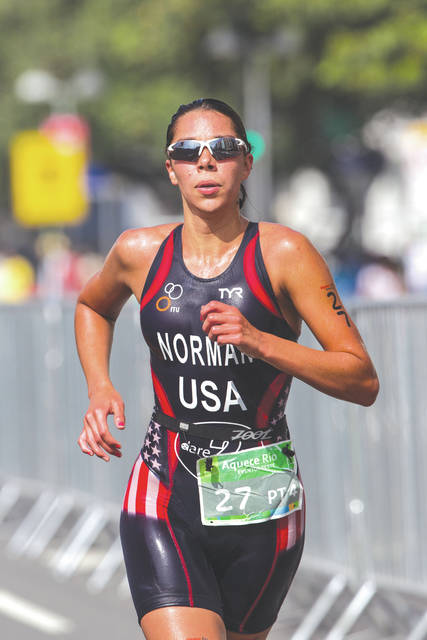 Grace Norman, shown here running in a 2015 paratriathlon test event in Rio de Janeiro, Brazil, has been testing a new prosthetic running leg while training in Sandy, Utah this summer.