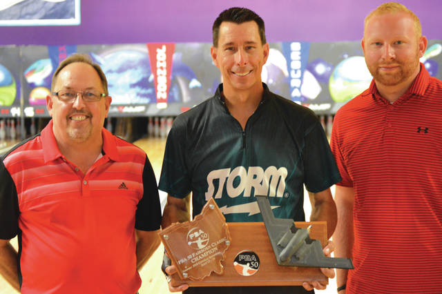 2018 Fairborn Central Classic winner Michael Haugen, Jr., (center) of Phoenix, poses with the Stealth Bomber Trophy with Bowl 10 proprietor Dave Flemming (left), and manager Jay Rapp after Sunday's final round of the PBA50 Tour's regional tournament in Fairborn.