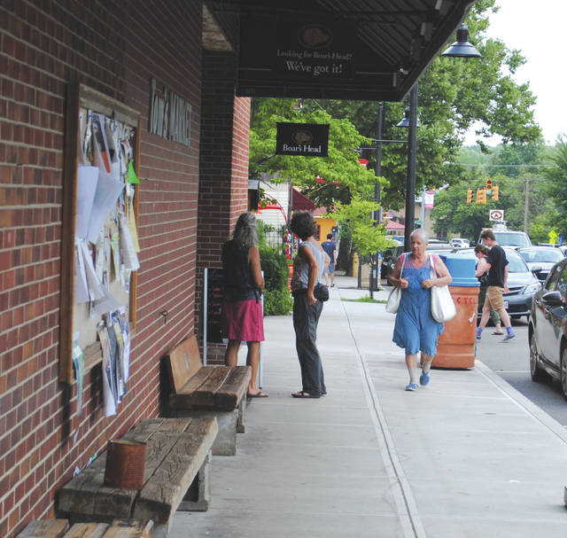 Whitney Vickers | Greene County News Downtown Yellow Springs was busy on a recent Monday as individuals made their way in and out of the shops that line Xenia Avenue in the village.