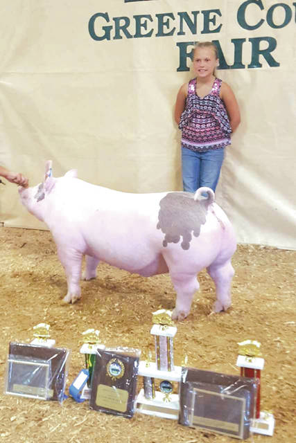 Submitted photo Sydnee Hawkins is a member of Greene Acres and will be showing pigs, a steer and a heifer this year at the Greene County Fair.