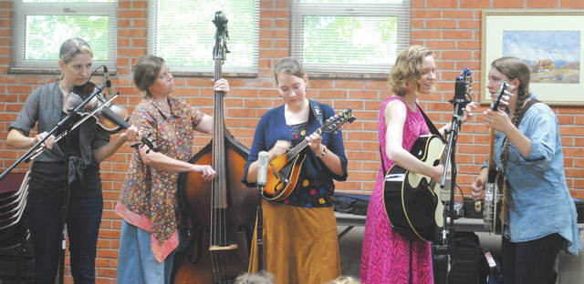 Whitney Vickers | Greene County News Lafferty Pike, an all-female bluegrass band hailing from Southwest Ohio, performed July 24 at the Yellow Springs Community Library.