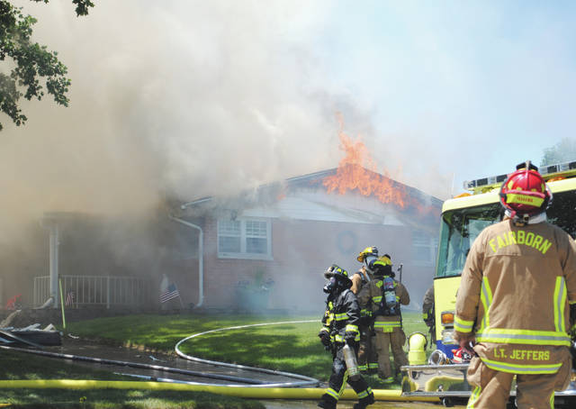 Whitney Vickers | Greene County News Flames engulfed a home July 6 on the 1400 block of Mapleridge Drive. Fairborn Fire Department officials said by the time they arrived, the homeowners were already outside; no injuries or fatalities occurred.