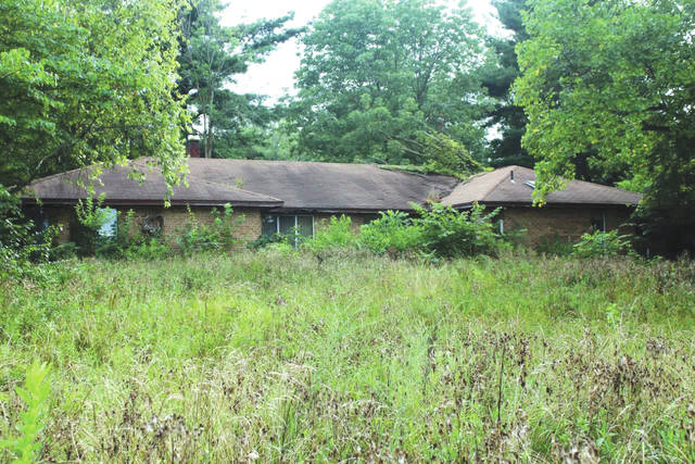 Linda Collins | Greene County News The vacant property, located at 4953 Bath Road, has noxious weeds and high grass, overgrown bushes, fallen trees, pungent odors and animal infestations.