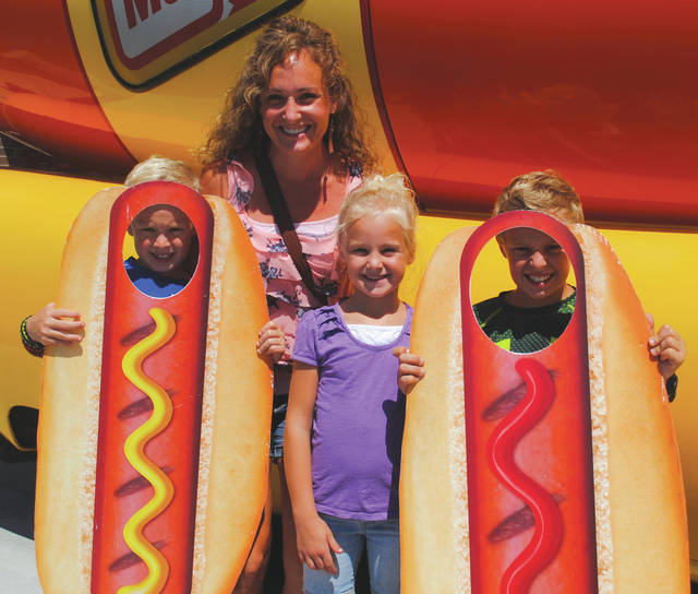 Local citizens Jessie Doggett, Colten Doggett, Lucas Doggett, and Claira Doggett enjoying the Wienermobile visit.
