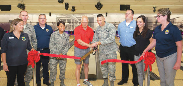Submitted photo Col. Thomas P. Sherman, 88th Air Base Wing commander, and Mike Hellmann, After Thoughts Bowling League secretary cut the ceremonial ribbon for the Wright-Patterson Air Force Base, Bowling Center Aug. 13, 2018. The center was reopening following a $585,000 refurbishing.