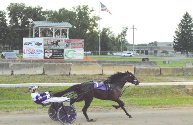 Chip Noble drives Fingerinthefrostin to victory in race no. 7, Wednesday night, Aug. 1 at the Greene County Fair. Noble recorded two early race wins on the first day of harness racing at the fair.