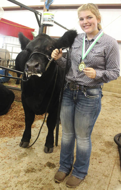 Claire Morris, with Tia, earned second place in her division of Market Beef Showmanship.
