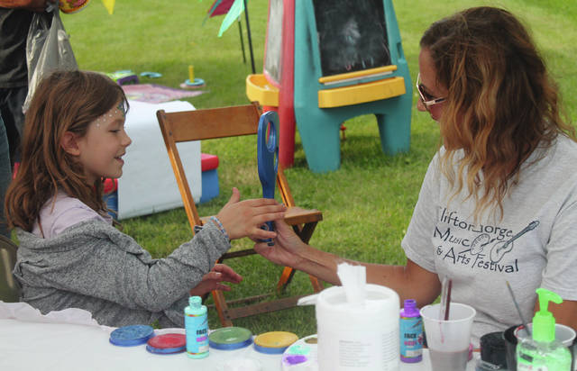 Anna Bolton | Greene County News Children enjoyed a game area and playground, a bouncy house, face painting and more at the Clifton Gorge Music & Arts Festival Aug. 24 in the Village of Clifton. During the two-day event, visitors ate festival food, shopped at local vendors, and explored a teepee.
