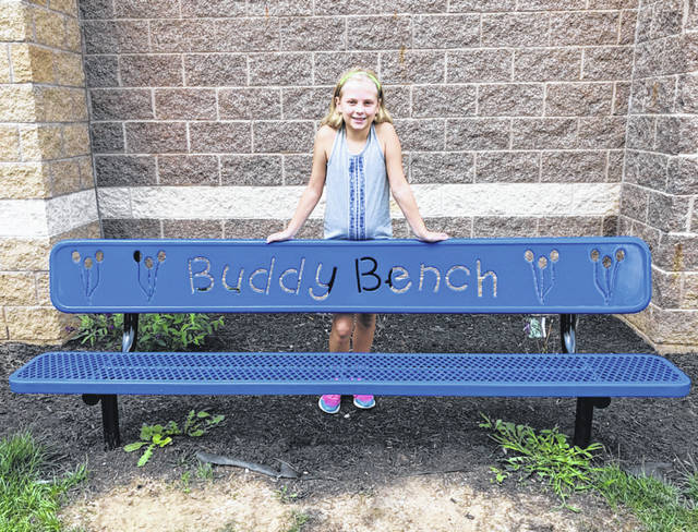 Submitted photo McKinley Elementary School fourth grade student Jillian Dameron successfully lobbied to have a buddy bench installed at the school. Her hope is that kids who need someone to play with during recess will sit at the bench and others will come over and engage with them.