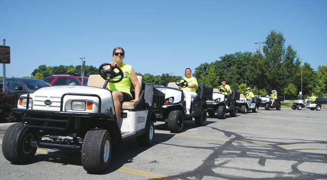 A fleet of volunteers and golf carts helped move the students.